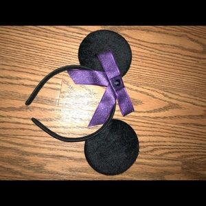 Mickey Mouse eats with purple bow